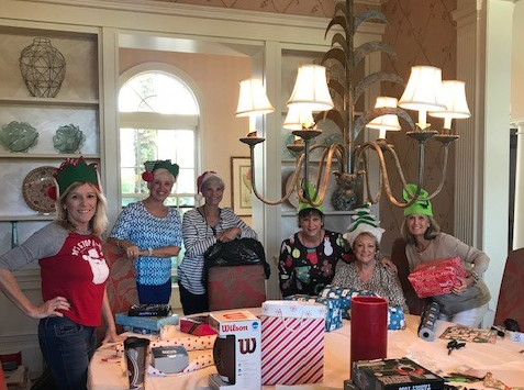 Indian River County Santa's Elves, from left, Petra King, Diane Wilhelm, Jane Jackson, Kim Seward, Wendy Pauk and Kim Johnson hard at work wrapping gifts for the youth living at the Hibiscus Village in Vero Beach.