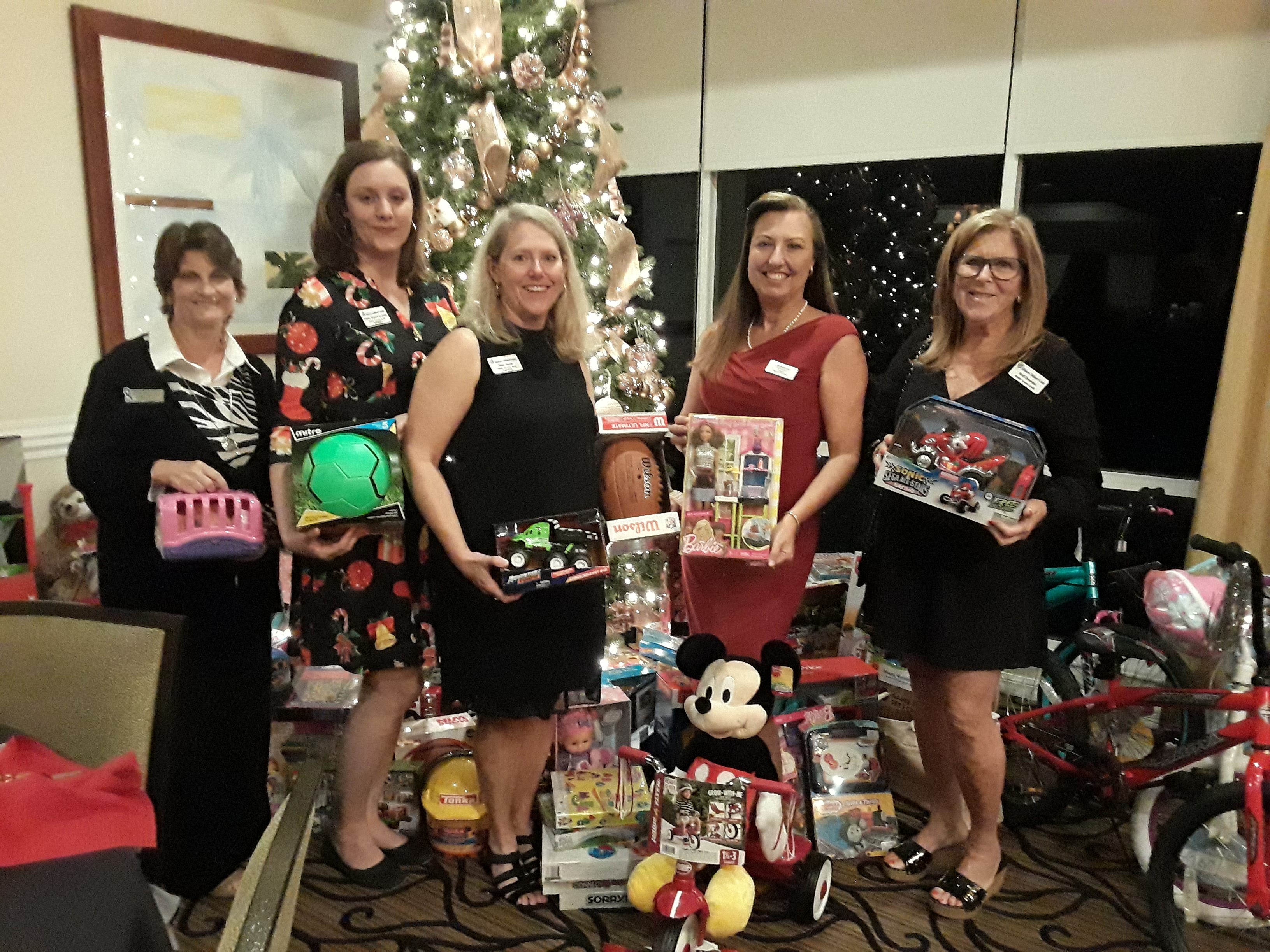 The Saelzer/Atlas Wealth Management Group of Raymond James held its annual holiday party to benefit Hibiscus' children's shelter in Jensen Beach. Santa's Elves attended the festivities and wrapped the gifts for the children. Pictured are, from left, Lori Swift, Ashley Braden-Knowles, Ellen Houts, Heidi Monsour and Andi Brennan.