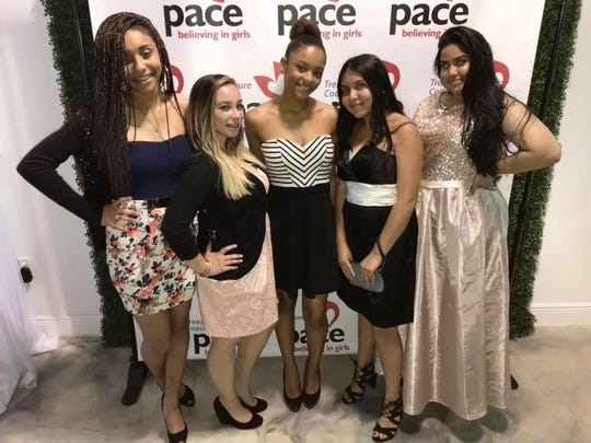 Quiona, left, Jeida, Naima, Hayle and Rachel are dressed to party at the 2018 winter fundraiser to benefit PACE Center for Girls.