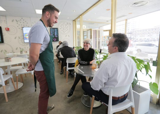 Sprouted Kitchen co-owner Adrian Guillen talks with customers at his restaurant at 201 E. Main in the One San Jacinto building (formerly Chase Bank). The plant-based restaurant serves a variety of vegan meals as well as smoothies and juices.