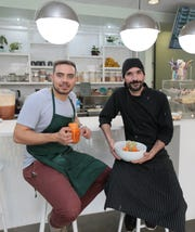Sprouted Kitchen co-owners Adrian Guillen, left, and Chef Carlos Padilla offer a plant-based menu along with smoothies and juices. The restaurant is carnivorous friendly for those who request it.