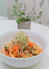 The vegetable pad thai from Sprouted Kitchen. The dish is made with zucchini, cucumber and carrot noodles and a traditional peanut sauce topped with sprouts.