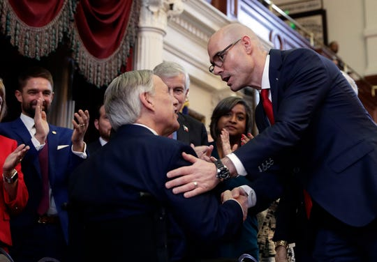New House Speaker Dennis Bonnen, R-Angleton, right, greets Gov. Greg Abbott, left, as he arrives to address the House members during the first day of the 86th Texas Legislative session Tuesday, Jan. 8, 2019, in Austin.