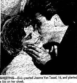 Elvis greeted Joanne Van Tassel, 16, and planted a kiss on her cheek.