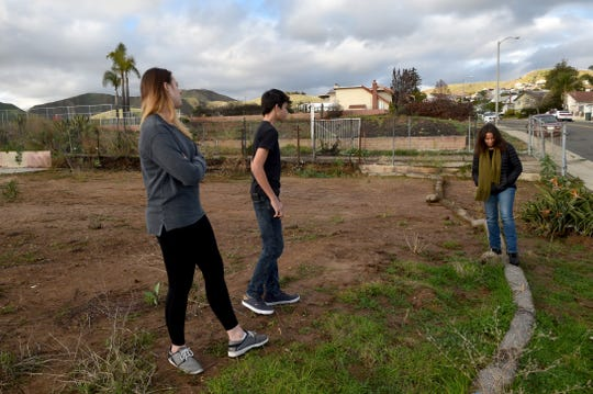 Sierra and Canyon Shannon, of Ventura, join their mother, Judy, for a visit to the property where their home was destroyed in the Thomas Fire in December 2017. The siblings created a documentary about the blaze and those who were affected by it.