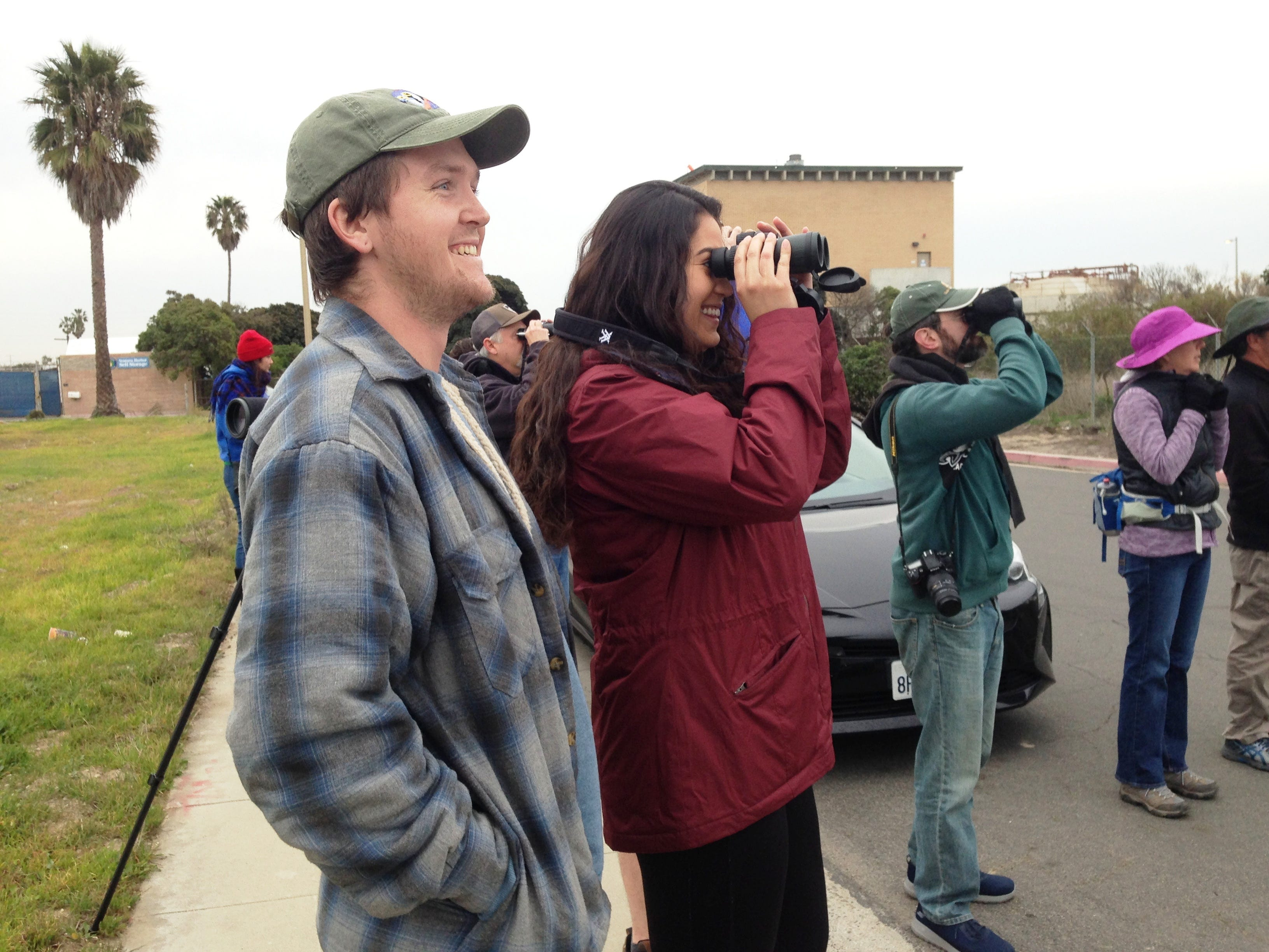 Zach Adkins and Jenna Utter look at birds from the parking area outside the settling ponds near Ventura Harbor. About 15 people gathered at this spot for the 2019 Christmas Bird Count on Saturday. Bird counts take place all over North America this time of year, with a few in the Caribbean and Latin America.