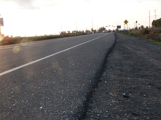 Broken glass on the westbound shoulder of Fifth Street, east of Pleasant Valley Road, where a fatal head-on crash occurred Monday morning south of Camarillo.