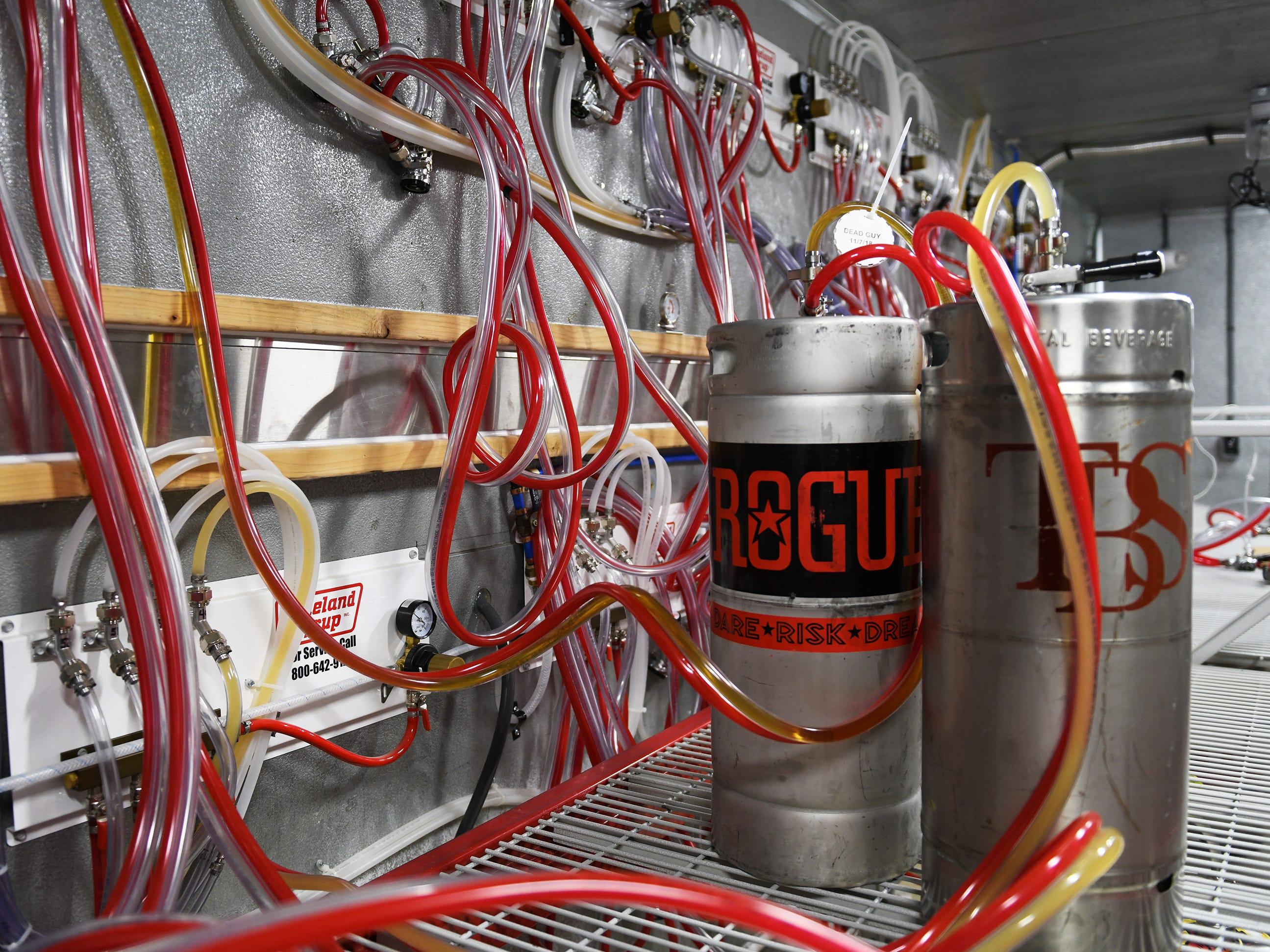 A keg of Rogue is tapped at The Brass Tap in Vineland as workers prepare for a January opening on Monday, Jan. 8. 2019.