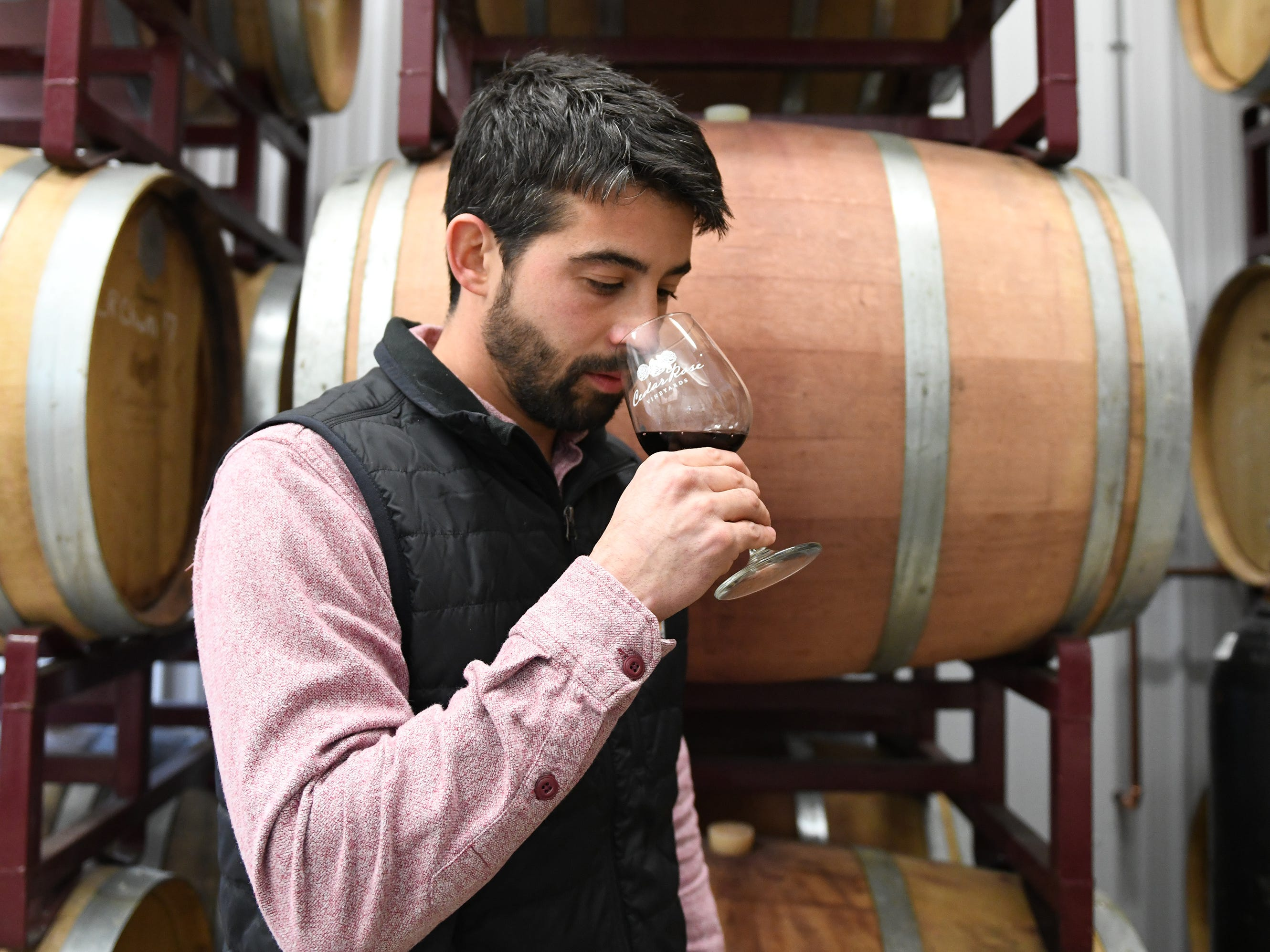 Cedar Rose Vineyards managing partner Steven Becker checks the aroma of a glass of wine on Tuesday, January 8, 2019.