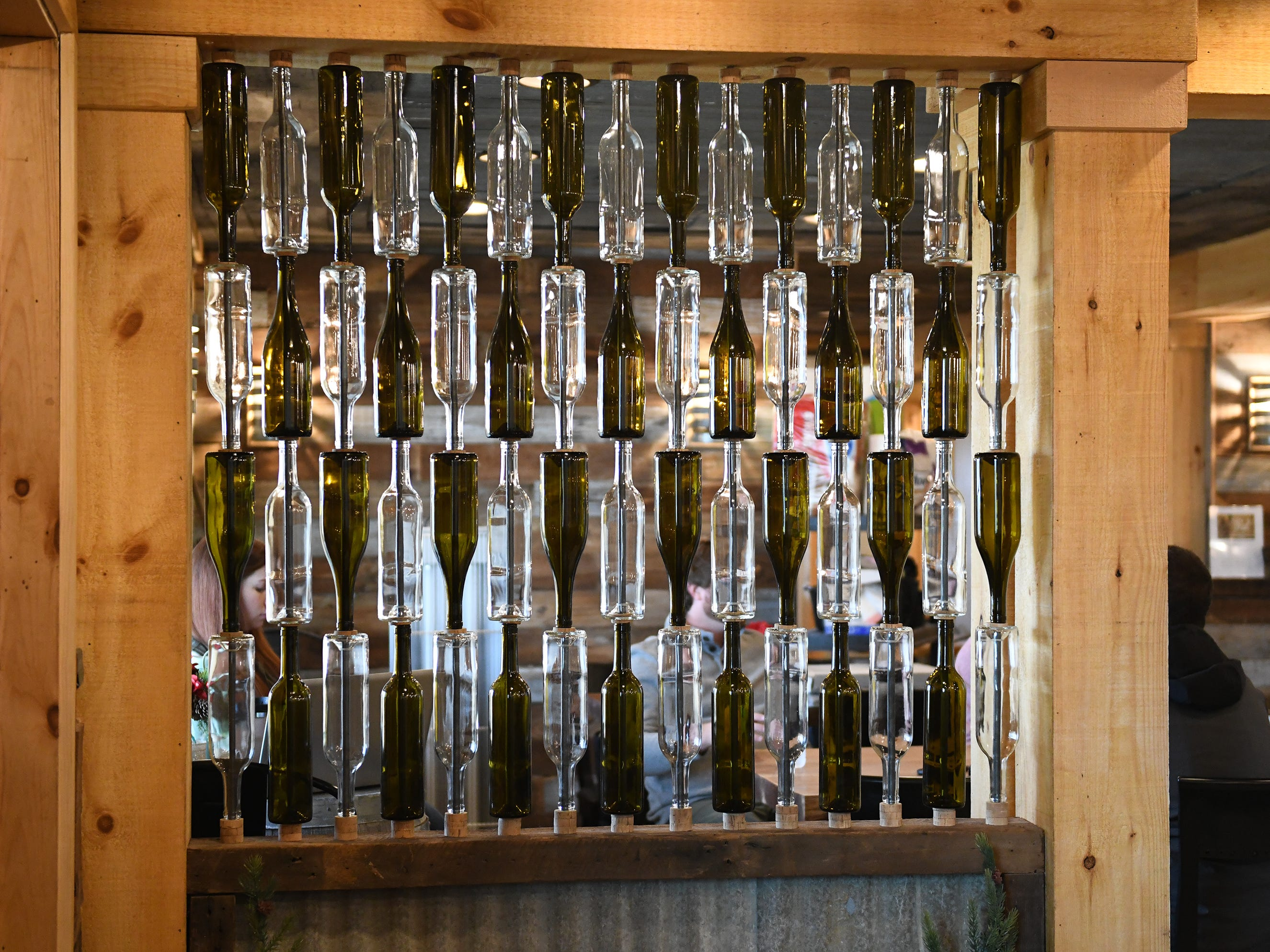 Stacked wine bottles create a artistic element to the entrance of Cedar Rose Vineyards in Rosenhayn on Tuesday, January 8, 2019.