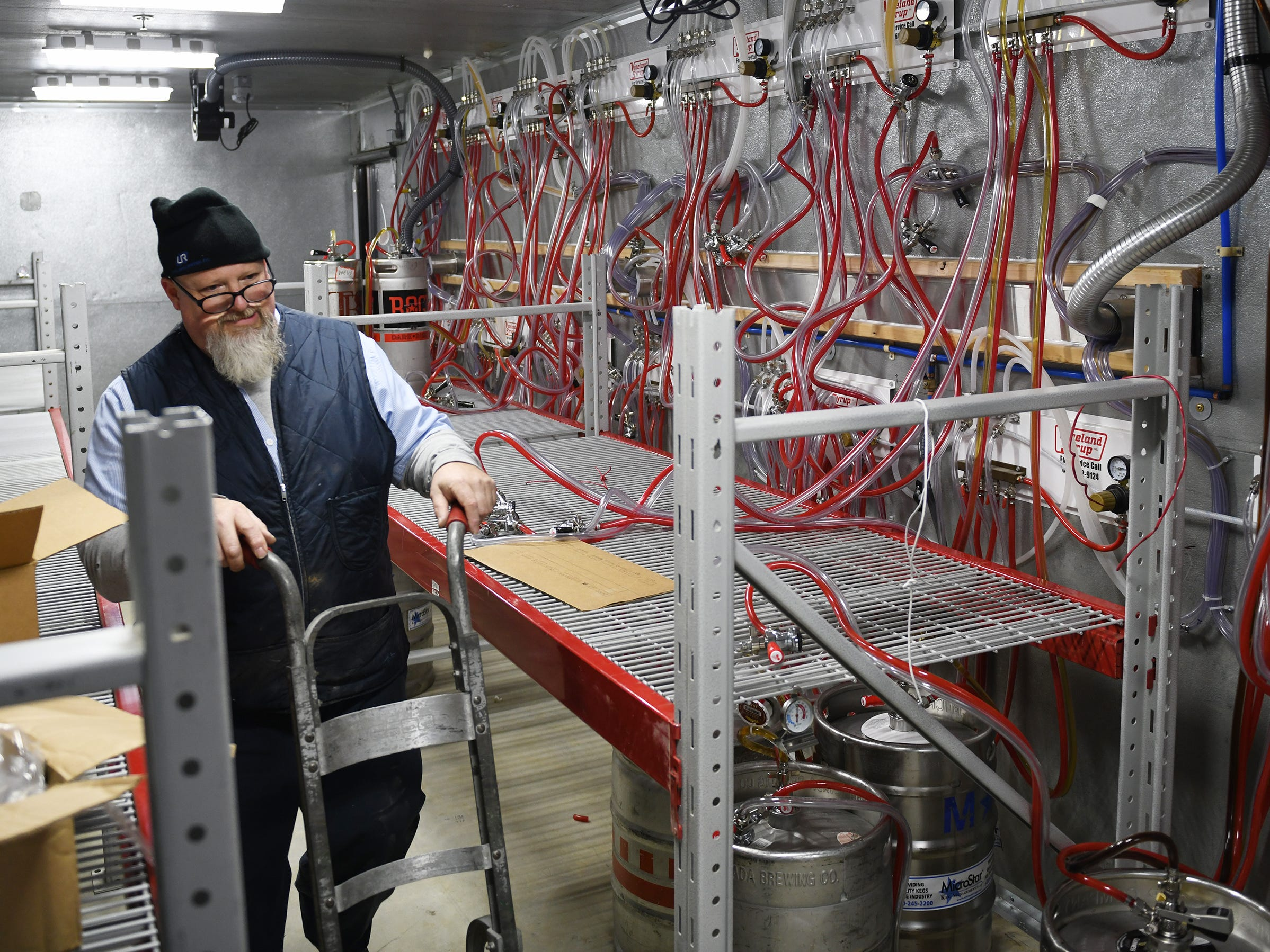 Mark Wendling, service technician for Vineland Syrup, works on getting a large selection of craft beers flowing at The Brass Tap in Vineland on Monday, Jan. 8. 2019.