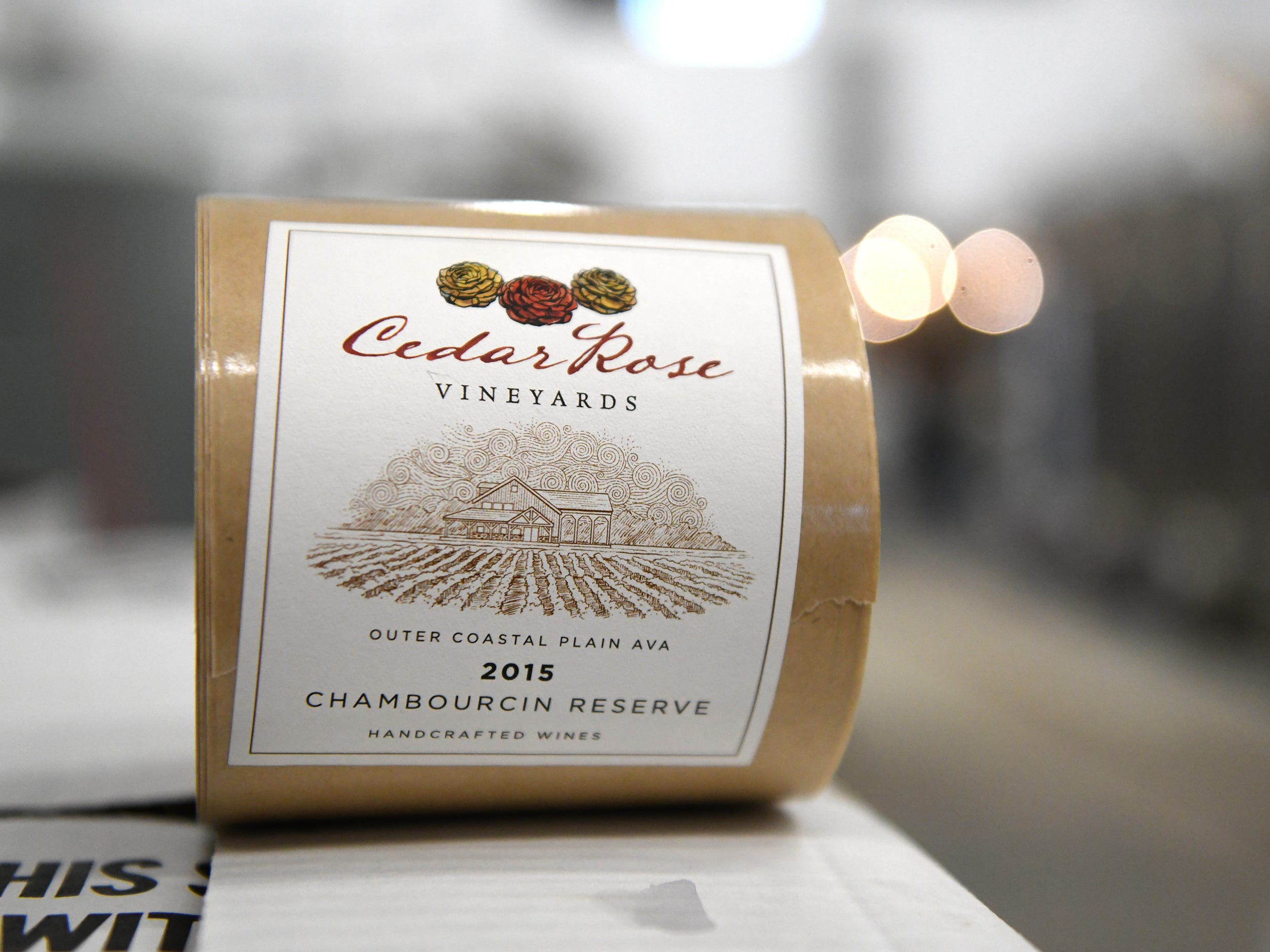 A roll of bottle labels for Cedar Rose Vineyards 2015 Chambourcin Reserve.