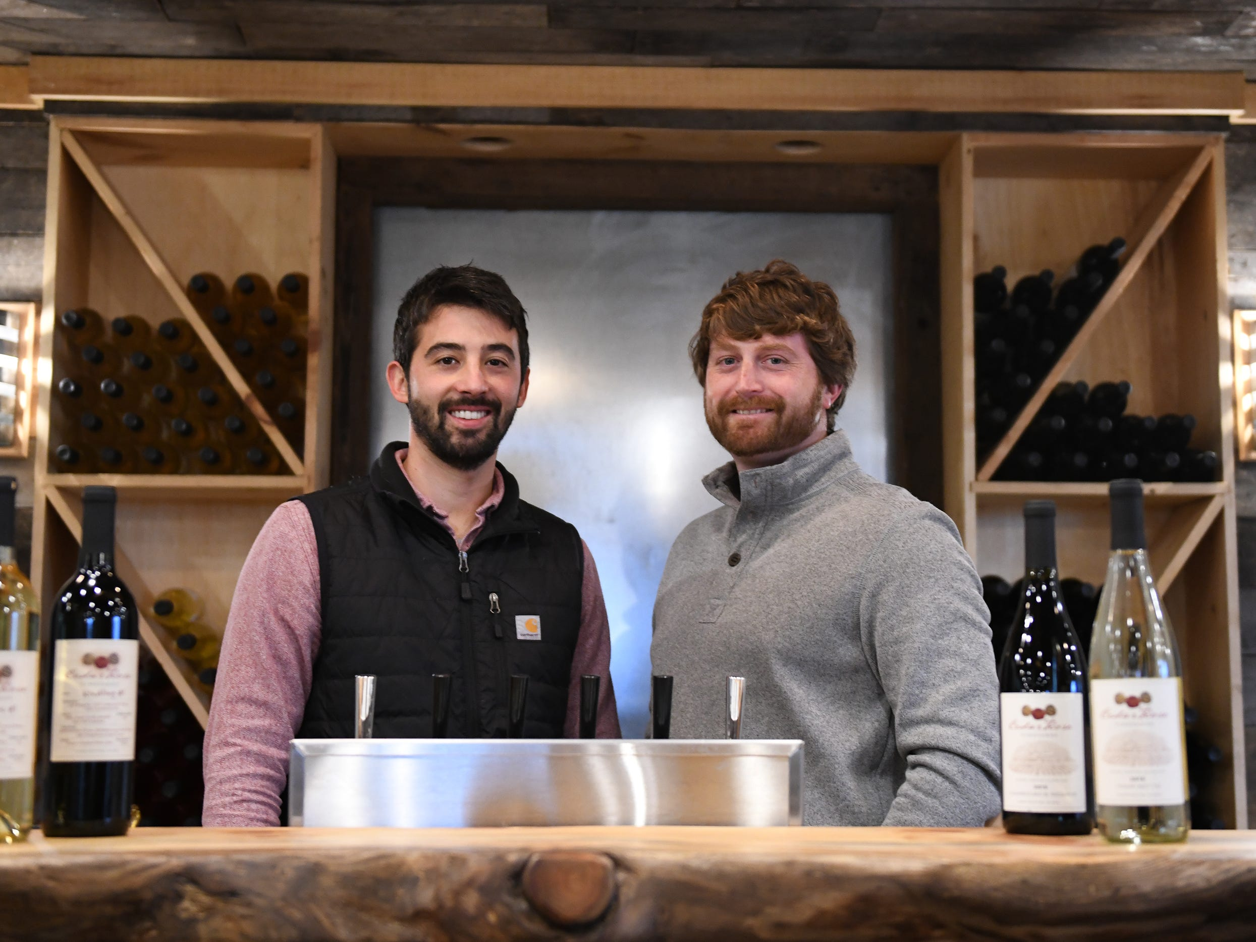 Cedar Rose Vineyards managing partners Steven Becker (left) and Dustin Tarpine stand behind the bar at the facilitie's tasting room in Rosenhayn on Tuesday, Jan. 8, 2019.