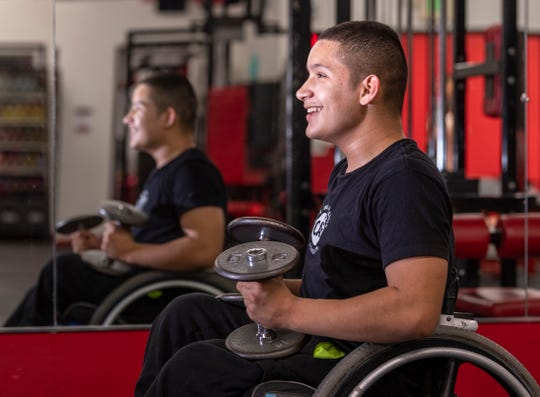 Matthew Rodriguez, 13, pauses between reps during his workout at Grizz's Power House Gym in Tulare on Monday, January 7, 2019.