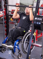 Matthew Rodriguez, 13, pulls up with his wheelchair at Grizz's Power House Gym in Tulare on Monday, January 7, 2019.