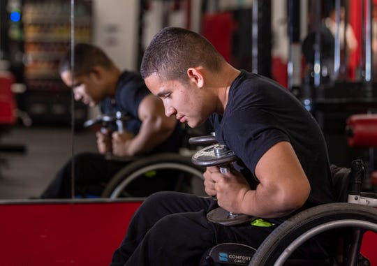 Matthew Rodriguez, 13, rests between reps during his workout at Grizz's Power House Gym in Tulare on Monday, January 7, 2019.