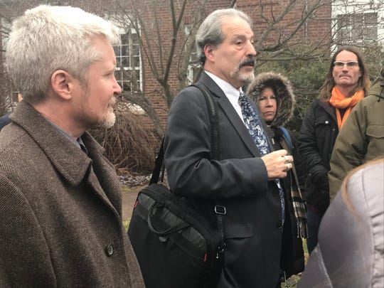 Attorney David Dorfman addresses supporters of three protesters who locked themselves inside a natural gas pipeline in Verplanck in 2016 after a court appearance in Cortlandt on Jan. 8, 2019. At Dorman's right is protester David Publow of Troy, N.Y.