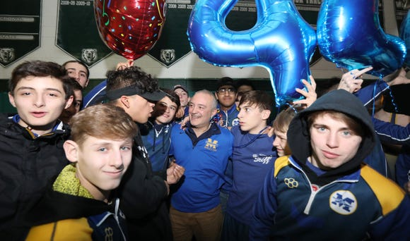 Mahopac wrestling coach Dennis DiSanto celebrates his 422nd career win with a 51-21 win at Brewster Jan. 7, 2019.