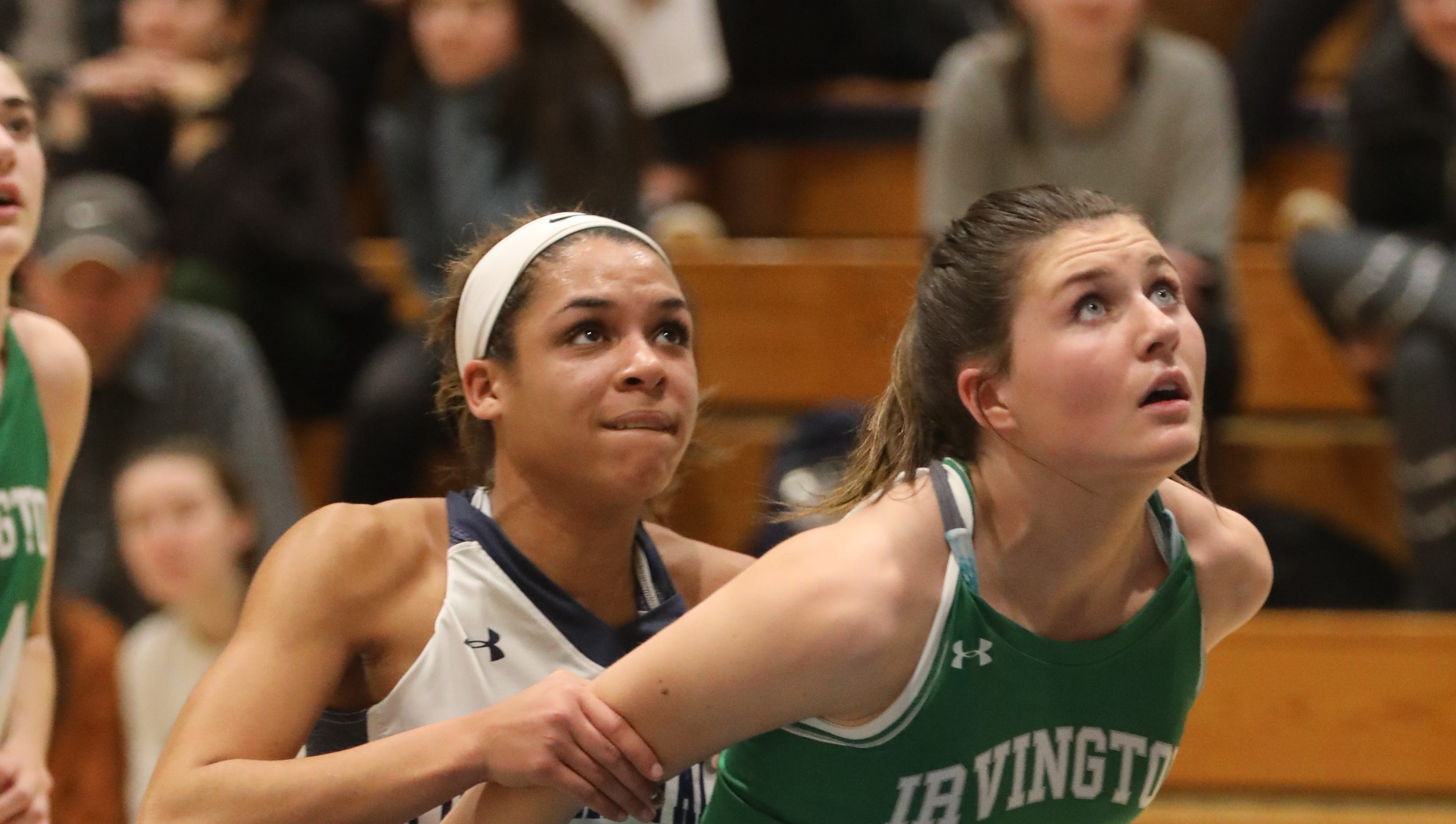Irvington's Mia Mascone (14) box out Putnam Valley's Cyera Daughtry (4) for the rebound during girls basketball game at Putnam Valley High School on Jan. 7, 2019. Irvington defeats Putnam Valley 42-34.