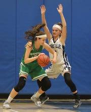 Putnam Valley's Arianna Stockinger (5) guards Irvington's Katie LeBuhn (15) during girls basketball game at Putnam Valley High School on Jan. 7, 2019. Irvington defeats Putnam Valley 42-34.