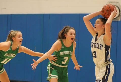 From left Irvington's Miranda Farman (10) and Nikki May (3) guards Putnam Valley's Kelli Venezia (13) during girls basketball game at Putnam Valley High School on Jan. 7, 2019. Irvington defeats Putnam Valley 42-34.