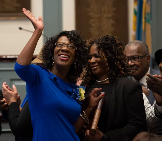 Kendra Johnson, D-Bear waves to the crowd after being sworn in for the start of the 150th General Assembly at Legislative Hall in Dover.
