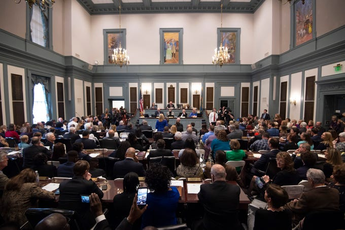 Legislators being sworn in for start of the 150th General Assembly at Legislative Hall in Dover.