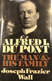 The legend about why Alfred I. du Pont built a stone wall with jagged glass shards around his Nemours estate is included in this 1990 biography.