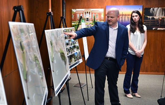 In this file photo, John Fielder and Katelyn Grass of Kimley-Horn presented three design concepts for the Veterans Memorial Plaza during the Lake Wichita Revitalization Committee meeting.