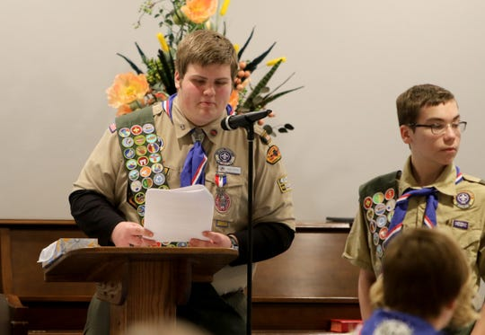 Todd Yurcho reads the names of the Eagle scouts recieving Eagle Palms at Floral Heights Methodist Church Monday, Jan. 7, 2019, during a dinner to celebrate 32 scouts earning Eagle Scout.