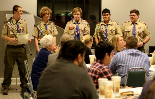 Eagle scouts recieve Eagle Palms at Floral Heights Methodist Church Monday, Jan. 7, 2019, during a dinner to celebrate 32 scouts earning Eagle Scout.
