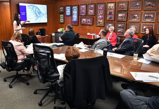 Katelyn Grass, landscape analyst for Kimley-Horn, describes one of three design concepts during a meeting of the Lake Wichita Revitalization Committee Tuesday morning. The designs are for the Veterans Memorial Plaza to be constructed near the public boat ramp.