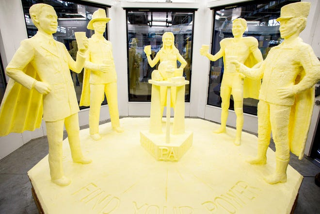 "The butter sculpture was revealed at the 103rd Pennsylvania Farm Show, Thursday, Jan. 3, 2019, in Harrisburg, Pa. The sculpture, made from more than 1,000 pounds of butter, follows the theme of this year's Pennsylvania Dairy campaign, ""Find Your Power."" It depicts an athlete, soldier, doctor, firefighter and dairy farmer wearing superhero capes."