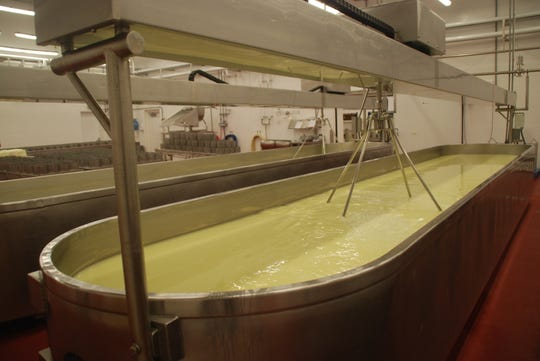 New additions to the Salemville cheese factory include larger state-of-the-art pasteuriization facilities and more space to make and age cheese. Here cheese is being made from the milk brought in to the factory from Amish farms.