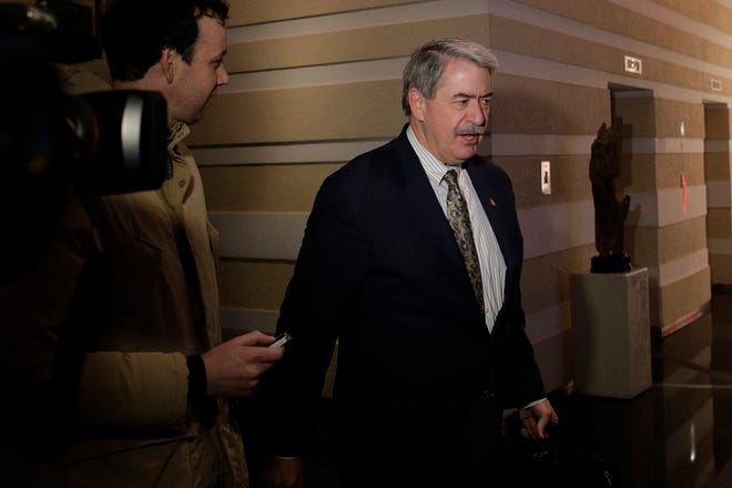 U.S. Undersecretary for Trade and Foreign Agricultural Affairs Ted McKinney is chased by journalists as he walks into a hotel after a second day of meetings with Chinese officials in Beijing, Tuesday, Jan. 8, 2019. An official Chinese newspaper warned Washington not to demand too much from Beijing as talks on ending their tariff war wound up a second day Tuesday with no word on possible progress.