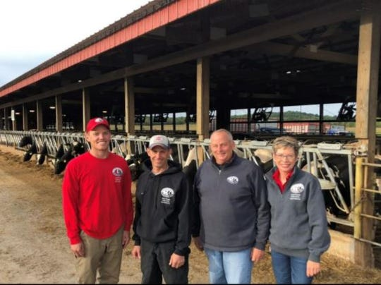Lloyd Jr. and Daphne Holterman purchased the farm from Lloyd's father, and have welcomed partners Jordan Matthews (left) and Tim Strobel into the operation.