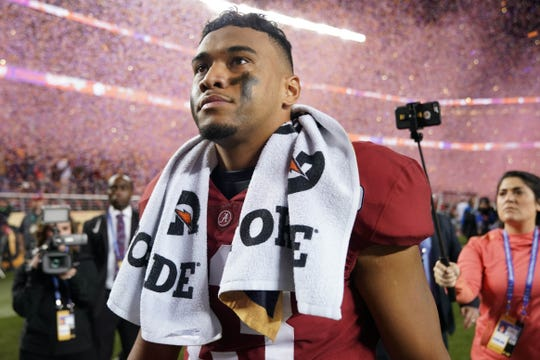 Alabama quarterback Tua Tagovailoa walks off the field after losing to Clemson in the national championship game.