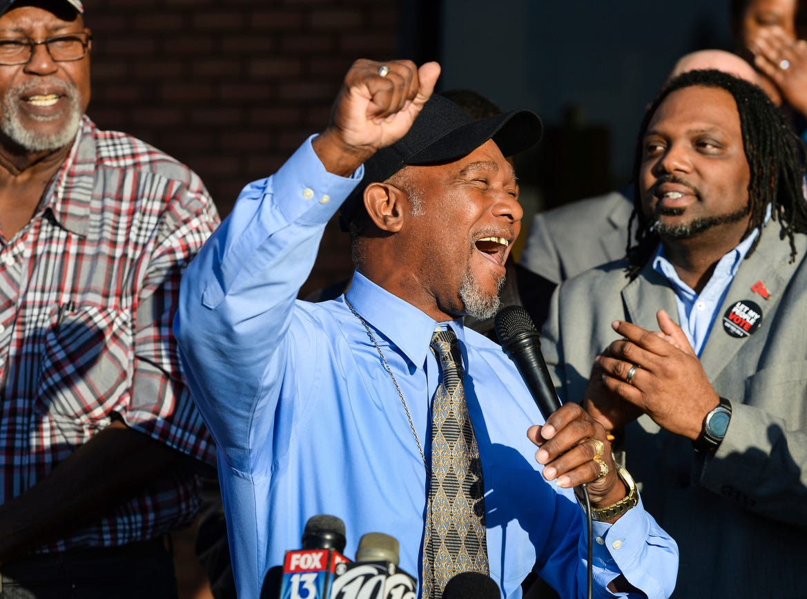 Pastor Wesley Tunstall praises God while addressing media at the Sarasota County Supervisor of Elections Office on Tuesday. Tunstall, a convicted felon, registered to vote on Tuesday, the first day that Amendment 4, which restores the right to vote for most felons, went into effect.