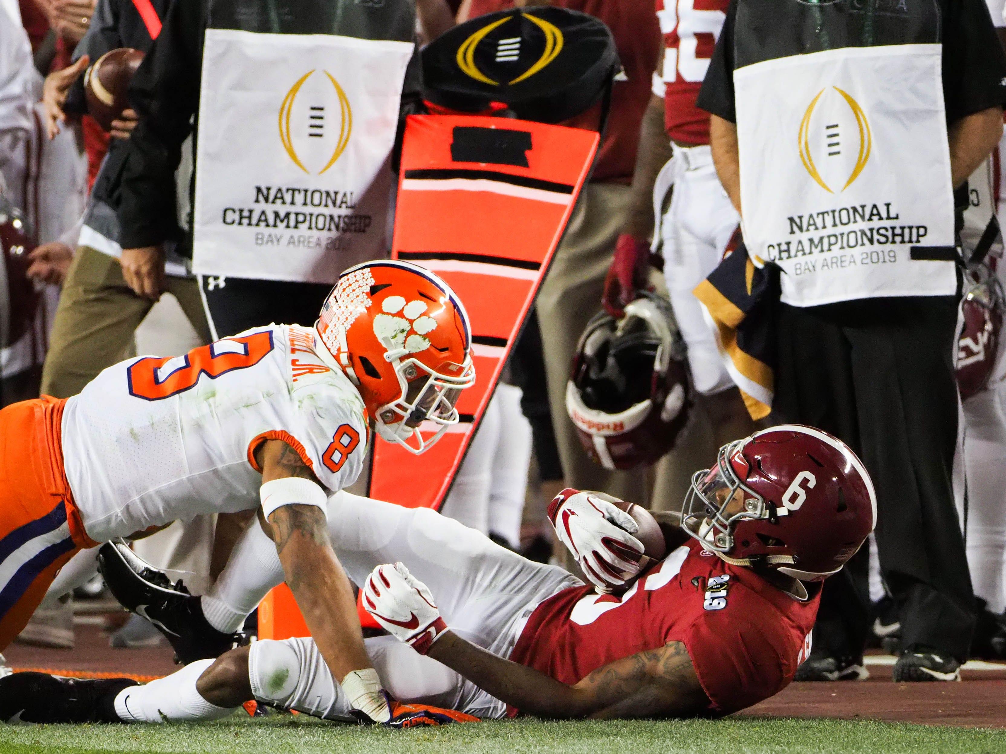 Clemson cornerback A.J. Terrell tackles Alabama's DeVonta Smith in the third quarter.