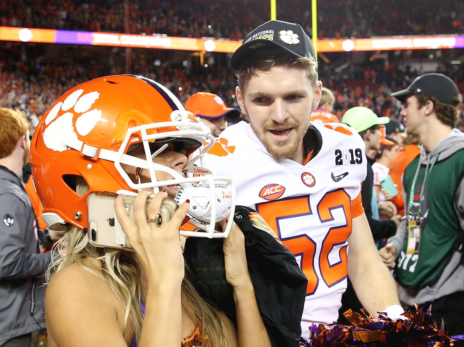 Clemson Tigers long snapper Patrick Phibbs (58) celebrates with a Tigers cheerleader after winning the national title.