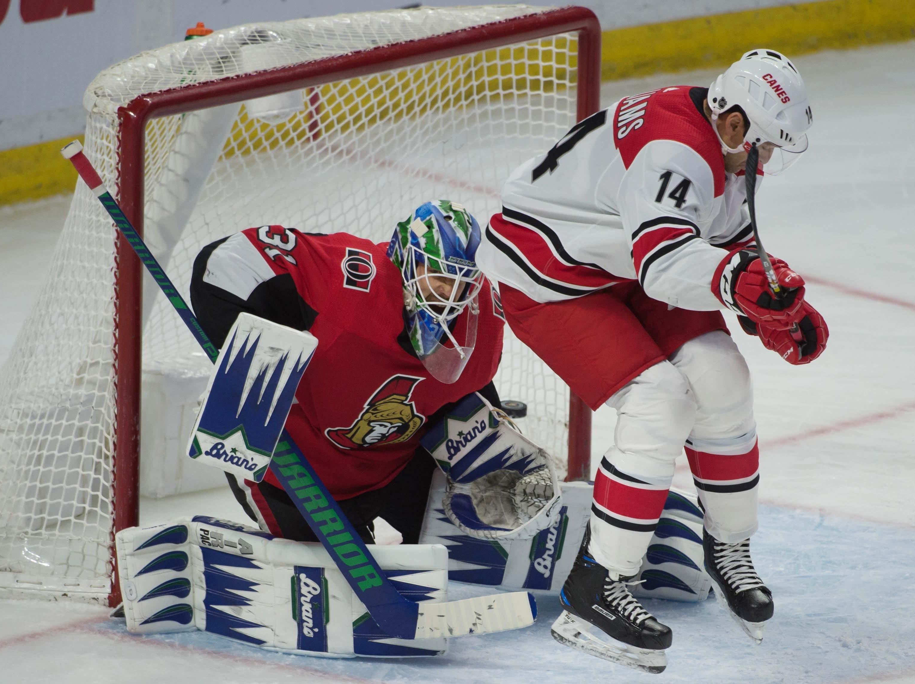 Jan. 6: Carolina Hurricanes right wing Justin Williams screens Ottawa Senators goalie Anders Nilsson in the third period.