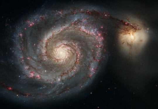 The Whirlpool Galaxy and companion galaxy as seen by the Hubble Space Telescope. This represents a merger between two galaxies similar in mass to the Milky Way and the Large Magellanic Cloud.