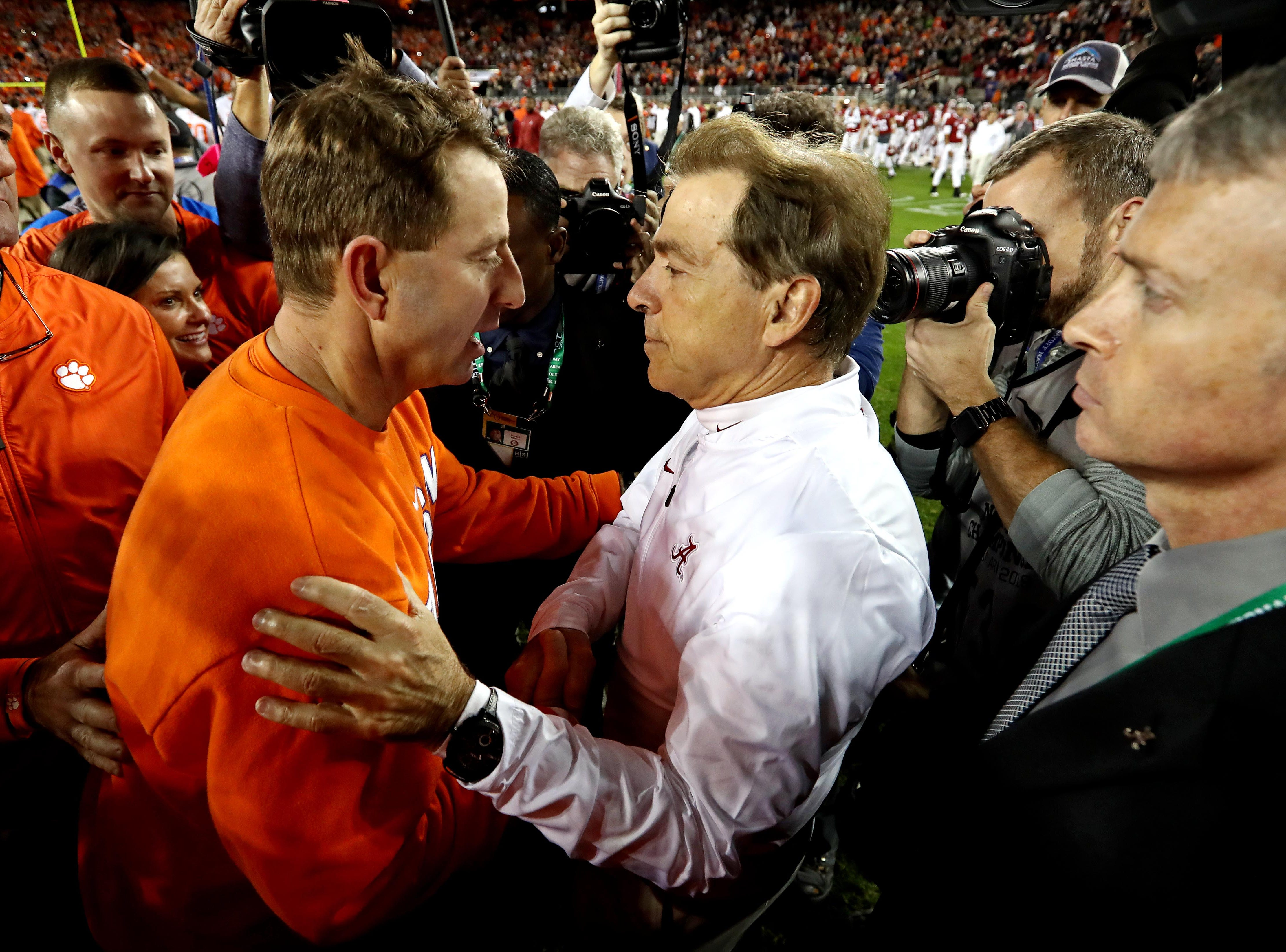 Dabo Swinney and Nick Saban shake hands at the end of the game.