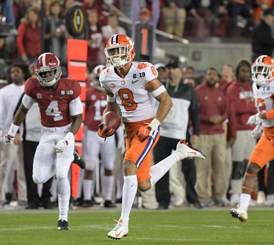 Clemson cornerback A.J. Terrell returns an interception for a touchdown against Alabama during the 2019 College Football Playoff championship game.