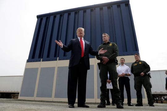 President Donald Trump is pictured speaking during a tour as he reviews border wall prototypes in San Diego, California.