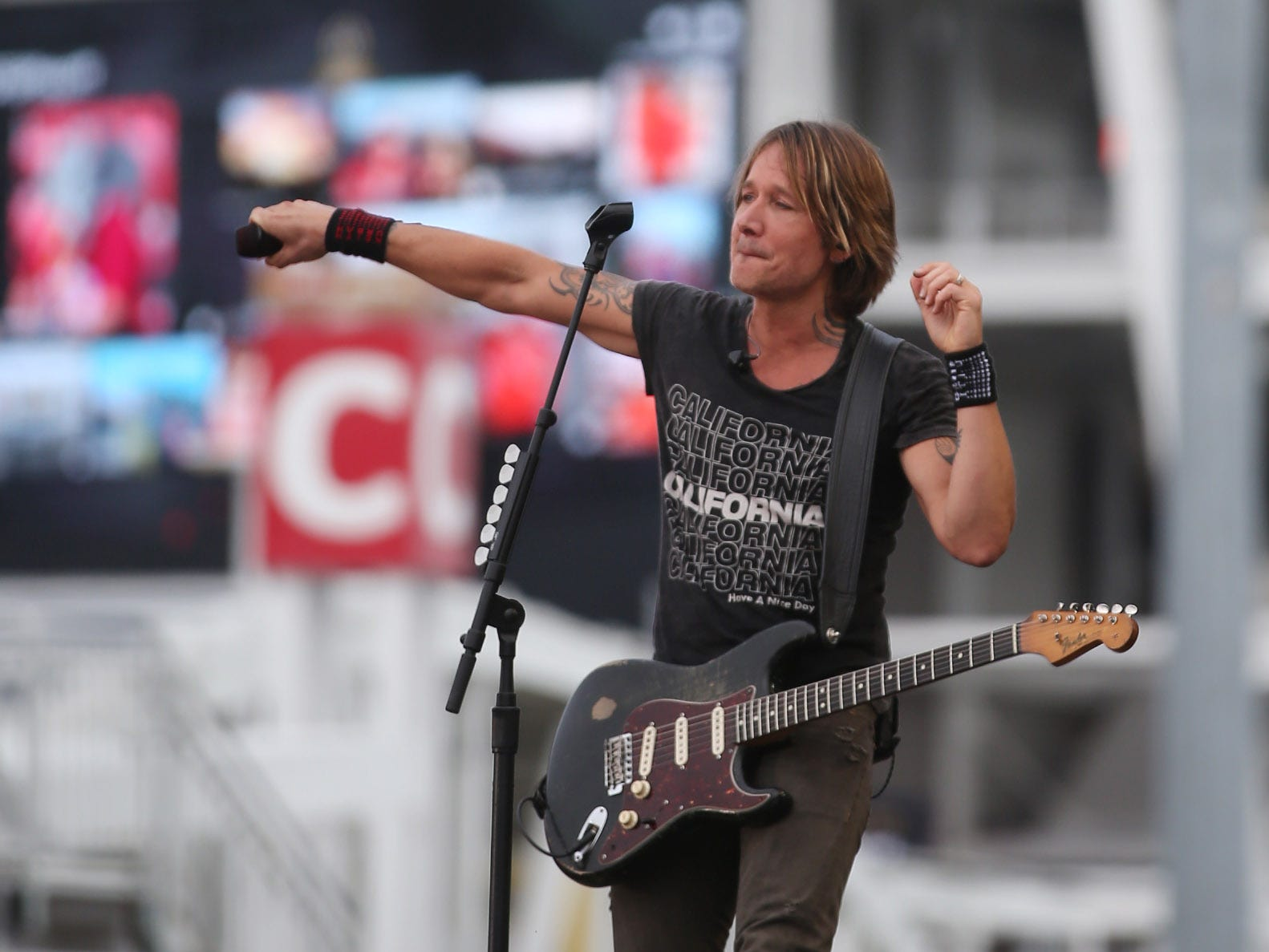 Keith Urban performs before the game.