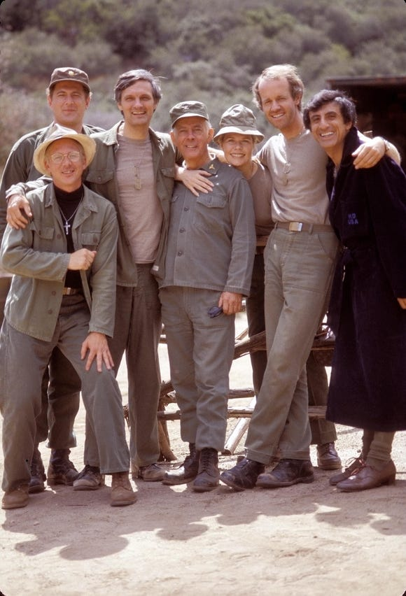 The cast of 'M*A*S*H' joins for a group photo.