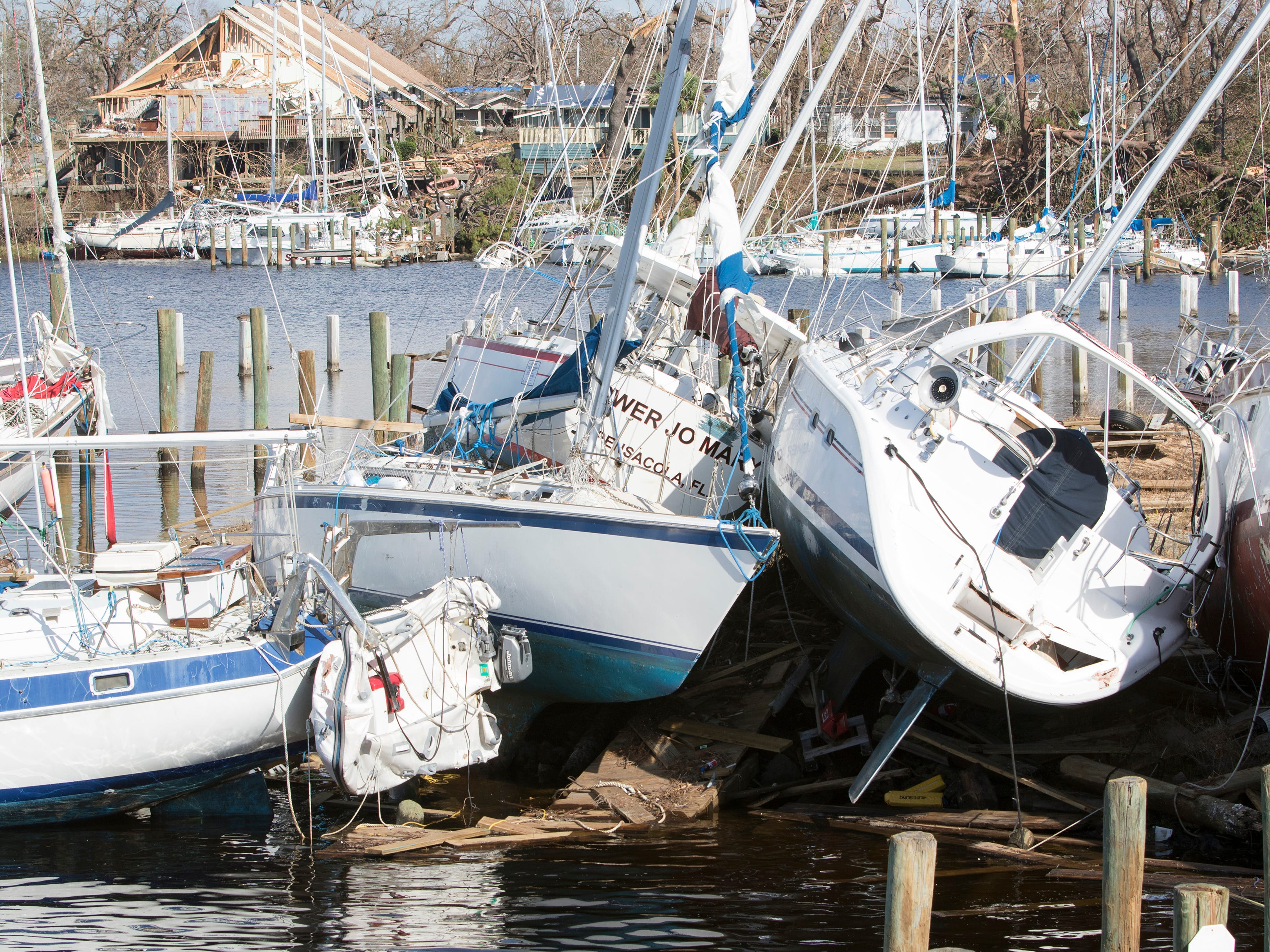 Boats lay stacked on each other in Massalina Bayou after Hurricane Michael in Panama City, Fla. on Oct. 18, 2018.