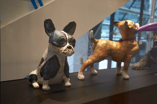 Sculptures of puppies are located throughout the Museum of the Dog.