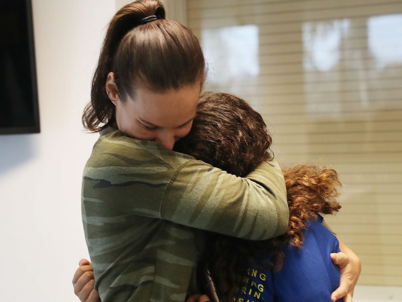 Erica Racz hugs her daughter after registering to vote at the Lee County Supervisor of Elections office in Fort Myers, Florida. Racz was able to register to vote for the first time after a new constitutional amendment took effect, which automatically restores voting rights to most people who have felonies on their record.